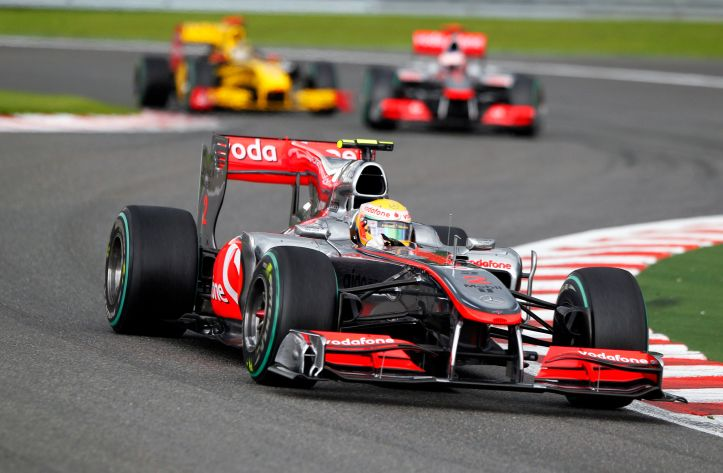 McLaren Formula One driver Lewis Hamilton of Britain leads the pack at the start of the Belgian F1 Grand Prix in Spa Francorchamps