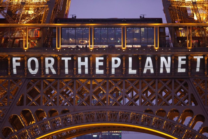 "The slogan ""For the planet"" is projected on the Eiffel Tower as part of the World Climate Change Conference 2015 (COP21) in Paris"