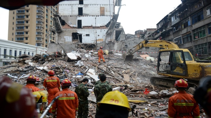 Rescue workers search at the site where residential buildings collapsed in Wenzhou