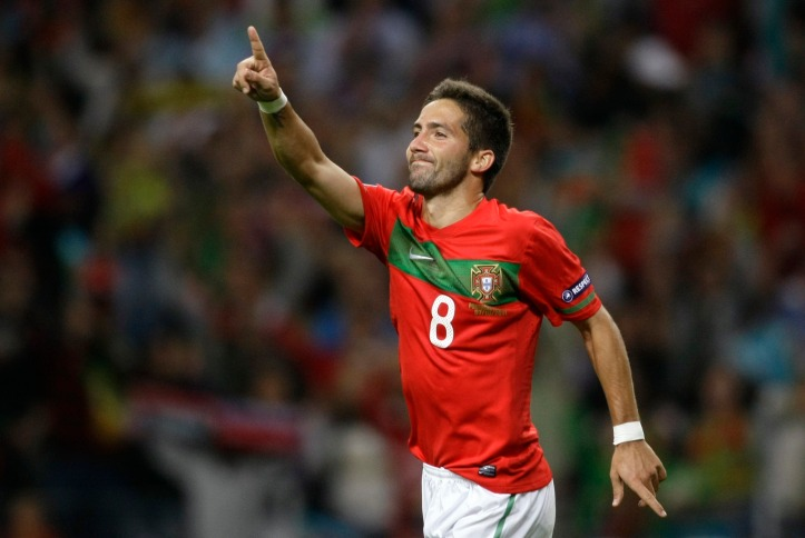Portugal's Moutinho celebrates his goal against Iceland during the Euro 2012 Group H qualifying soccer match against at the Dragon stadium in Porto