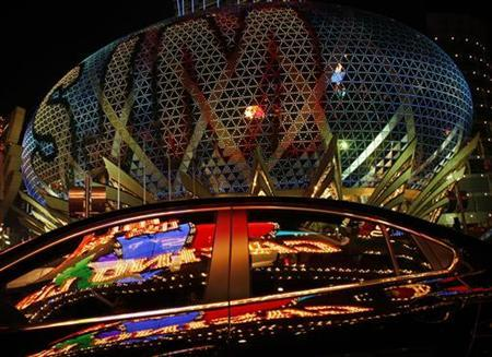 A car reflecting Casino Lisboa stops in front of Grand Lisboa, the two major casinos of SJM Holdings founded by Macau tycoon Stanley Ho, in Macau