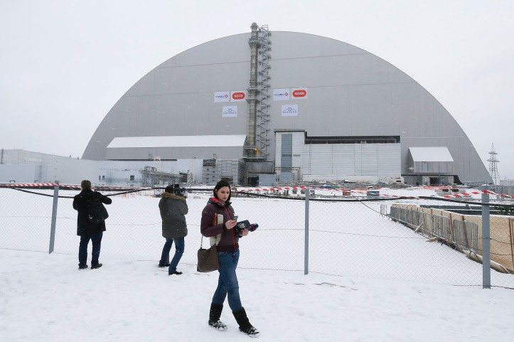 The opening of a new protective shelter over the remains of the nuclear reactor Unit 4, at Chernobyl nuclear power plant