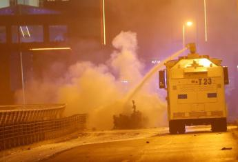 Police extinguish a burning car using a water cannon after a blast in Istanbul, Turkey, December 10, 2016. REUTERS/Murad Sezer
