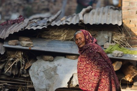 epa05720640 A Nepalese woman stands near her makeshift shelter in Bhaktapur, Nepal, 16 January 2017. Bhaktapur was heavily affected by the devastating earthquake that stuck Nepal in 2015. Due to the slow pace of the government's distribution of aid for reconstruction, many people are spending their second winter without a home.  EPA/HEMANTA SHRESTHA