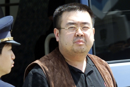 (FILES) This file photo taken on May 4, 2001 shows an immigration officer (L) escorting Kim Jong-Nam, son of North Korean leader Kim Jong-Il, getting off a bus to board an ANA905 (All Nippon Airways) airplane at Narita airport near Tokyo. Kim Jong-Nam, the half-brother of North Korean leader Kim Jong-Un has been assassinated in Malaysia, South Korea's Yonhap news agency said on February 14, 2017. / AFP PHOTO / TOSHIFUMI KITAMURA