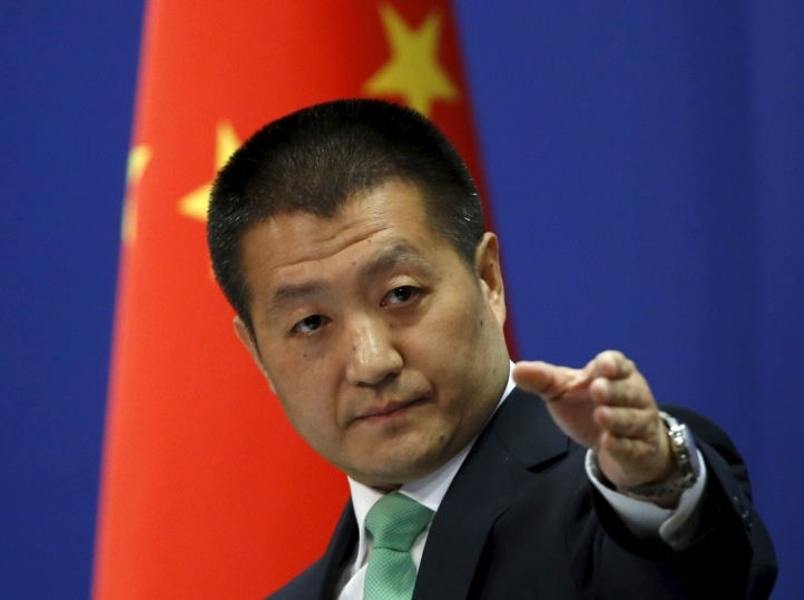Chinese Foreign Ministry spokesman Lu Kang points out a reporter to receive a question at a regular news conference in Beijing