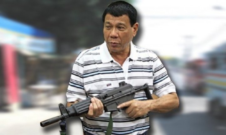 duterte-poses-with-automatic-weapon