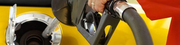 person-filling-fuel-at-fuelstation