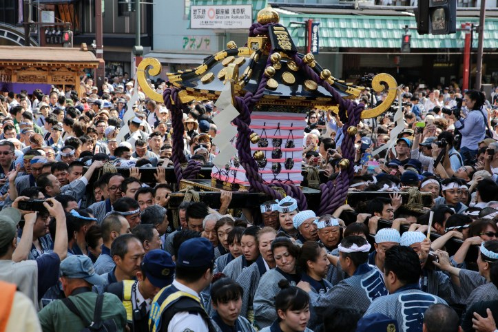 Revelers enjoy carrying portable shrines during the Sanja Matsuri festival in Tokyo