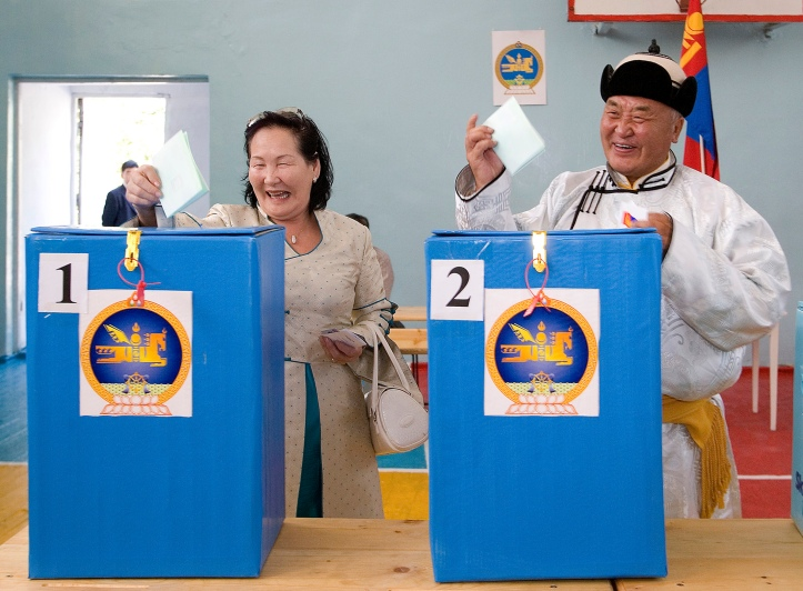 Residents cast their ballots at a polling station in Ulan Bator