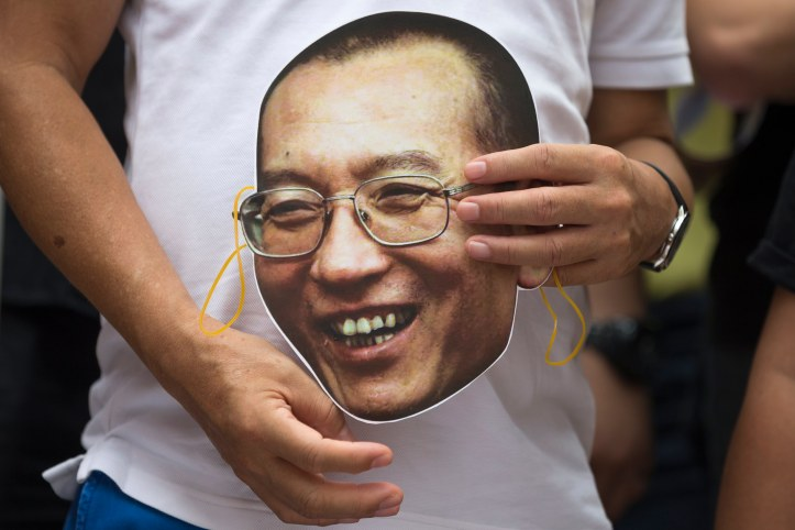 Protest with masks of Liu Xiaobo at China Liaison Office in Hong Kong