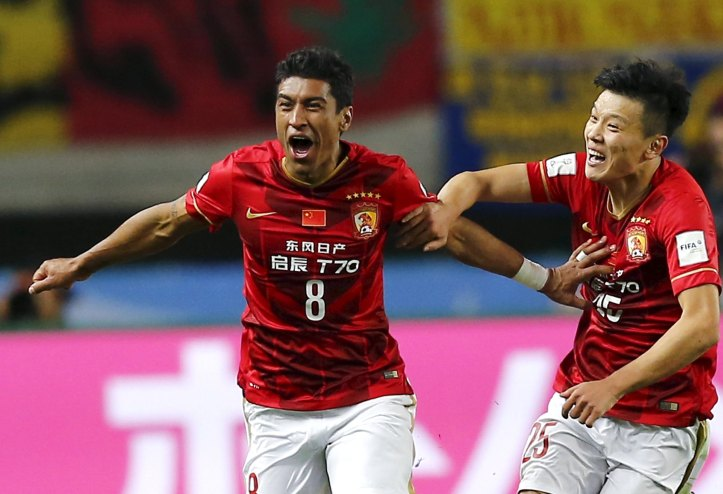 Paulinho of China's Guangzhou Evergrande celebrates with teammate Zou Zheng after scoring against Mexico's Club America during their Club World Cup quarter-final soccer match in Osaka